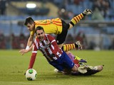 Atletico Madrid's forward Adrian Lopez (L) vies with Sant Andreu's goalkeeper Morales during the Spanish Copa del Rey (King's Cup) finals stage second-leg football match on December 18, 2013