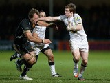Danny Barnes of Newcastle attempts to hand off Kai Horstmann of Exeter during the Aviva Premiership match between Exeter Chiefs and Newcastle Falcons at Sandy Park on December 21, 2013
