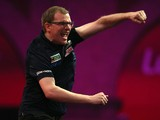 Mark Webster of Wales celebrates winning his first round match against Mensur Suljovic of Austria during the Ladbrokes.com World Darts Championship on Day Six at Alexandra Palace on December 19, 2013
