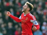 Southampton's English midfielder Adam Lallana celebrates scoring the opening goal during the English Premier League football match between Southampton and Tottenham Hotspur at St Mary's Stadium in Southampton, southern England on December 22, 2013