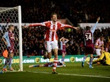 Peter Crouch of Stoke City celebrates as he scores their second goal during the Barclays Premier League match between Stoke City and Aston Villa at Britannia Stadium on December 21, 2013