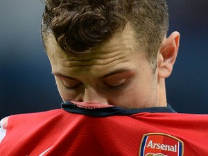 Arsenal's English midfielder Jack Wilshere reacts at the final whistle after his team were beaten 6-3 during the English Premier League football match between Manchester City and Arsenal at the Etihad Stadium in Manchester, northwest England, on December