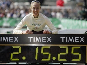 Paula Radcliffe poses next to her world record time after the London Marathon on April 13, 2003