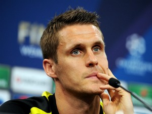 Sebastian Kehl speaks during a Borussia Dortmund press conference ahead of the UEFA Champions League final match against FC Bayern Muenchen at Wembley Stadium on May 24, 2013
