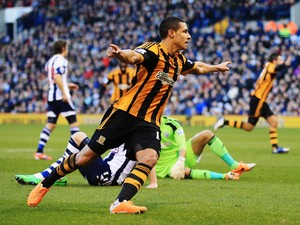 Jake Livermore of Hull City shoots celebrates scoring during the Barclays Premier League match between West Bromwich Albion and Hull City at The Hawthorns on December 21, 2013