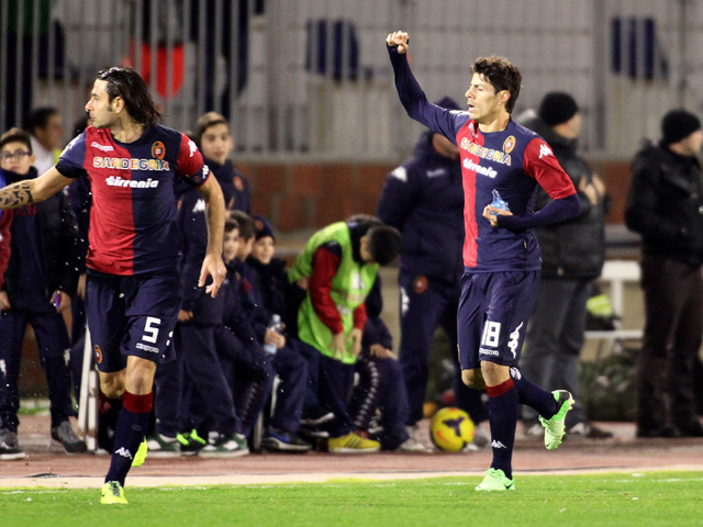 Nenè of Cagliari celebrates after scoring a goal during the Serie A match between Cagliari Calcio and SSC Napoli at Stadio Sant'Elia on December 21, 2013