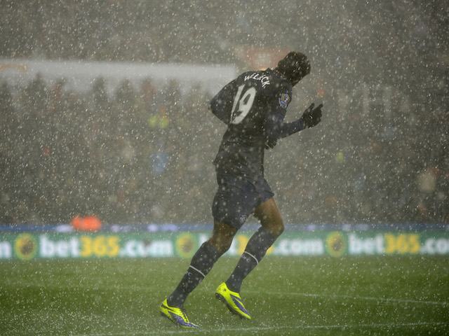 Danny Welbeck of Manchester United in action as heavy hail falls during the Capital One Cup Quarter Final against Stoke City on December 18, 2013