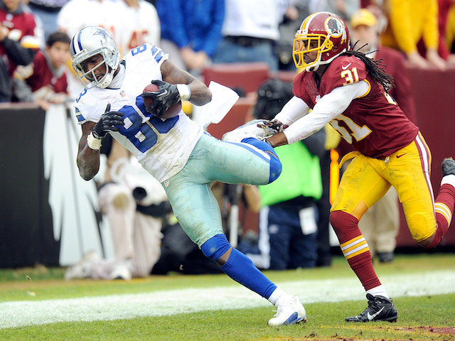 Dez Bryant of the Dallas Cowboys catches a touchdown in the second quarter against the Washington Redskins at FedExField on December 22, 2013