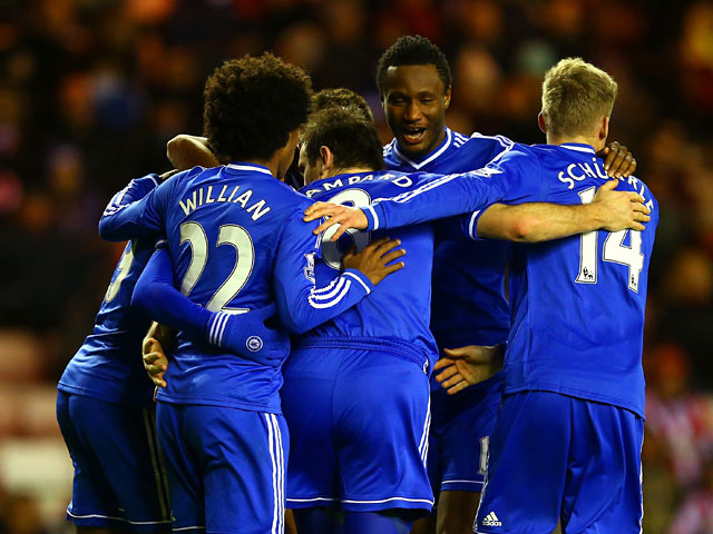 Chelsea's Frank Lampard celebrates with teammates after scoring the opening goal against Sunderland during their Capital One Cup quarter-final match on December 17, 2013