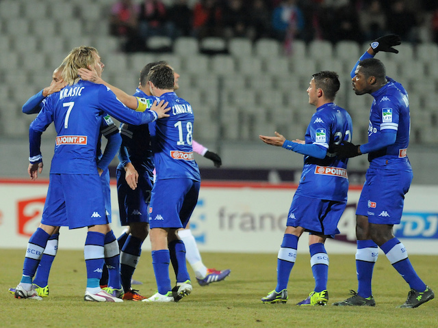 Bastia's Brazilian forward Ilan Araujo is congratulated by team mates after scoring a goal during a French League Cup round of sixteen football match against Evian on December 18, 2013