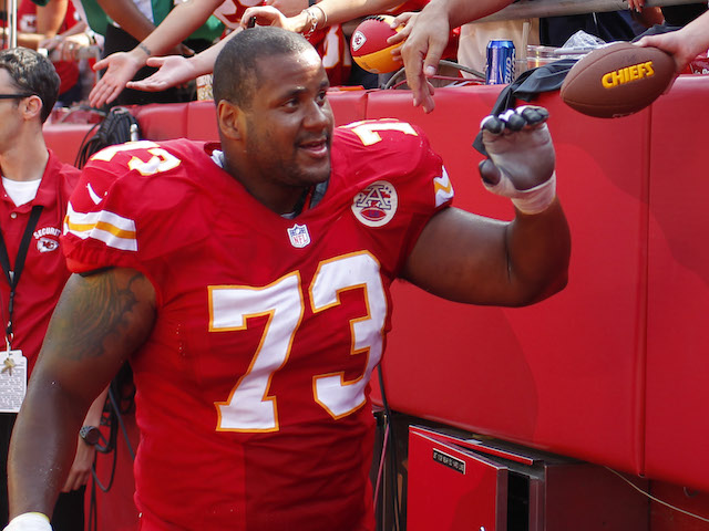 Jon Asamoah of the Kansas City Chiefs greets fans after the victory over the Dallas Cowboys September 15, 2013