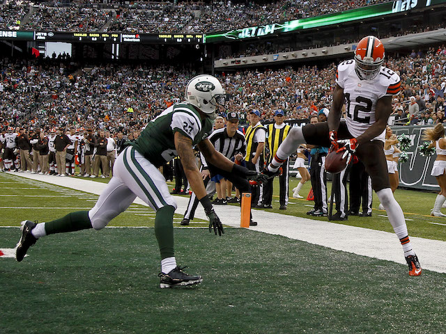 Josh Gordon of the Cleveland Browns tries to catch a pass in front of Dee Milliner of the New York Jets during their game at MetLife Stadium on December 22, 2013