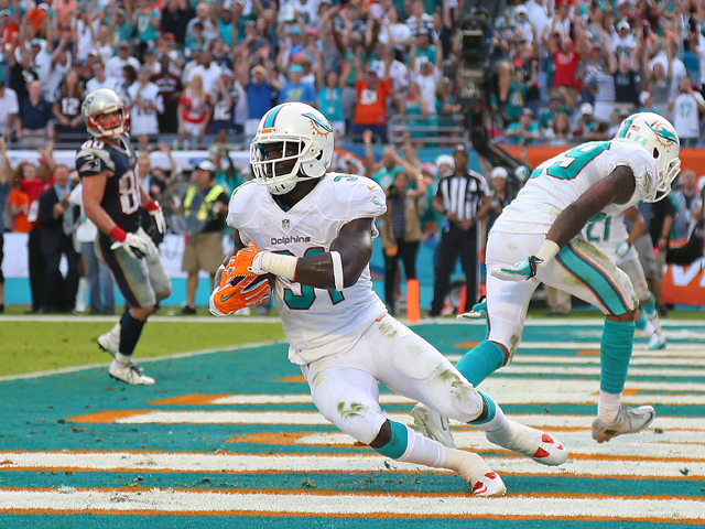 Michael Thomas #31 of the Miami Dolphins celebrates a game clinching interception during a game against the New England Patriots at Sun Life Stadium on December 15, 2013