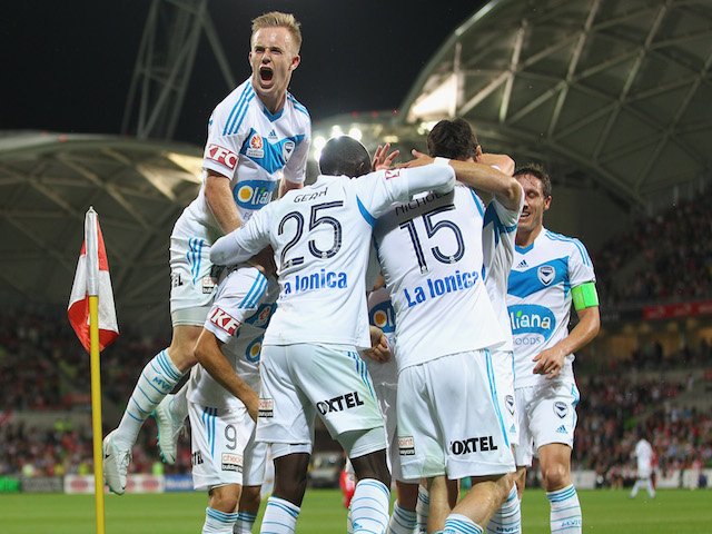Mitch Nichols of the Victory is congratulated by his teammates after scoring his second goal during the round 11 A-League match against Melbourne Heart on December 21, 2013