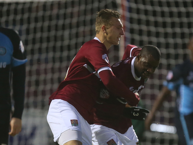 Izale McLeod of Northampton Town is congratulated by team mate Luke Norris after scoring his sides goal during the Sky Bet League Two match between Northampton Town and Wycombe Wanderers at Sixfields Stadium on December 21, 2013