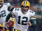 Quarterback Aaron Rodgers of the Green Bay Packers runs with the ball against the Chicago Bears during a game at Soldier Field on December 29, 2013