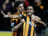George Boyd of Hull City congratulates team-mate Ahmed Elmohamady after scoring a goal during the Barclays Premier League match between Hull City and Fulham on December 28, 2013