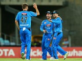 Callum Ferguson of the Strikers celebrates with team mates after running out Kurtis Patterson of the Thunder during the Big Bash League match between Sydney Thunder and the Adelaide Strikers at ANZ Stadium on December 27, 2013