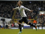 Tottenham Hotspur's Danish midfielder Christian Eriksen celebrates scoring the opening goal of the English Premier League football match between Tottenham Hotspur and West Bromwich Albion at White Hart Lane in north London on December 26, 2013