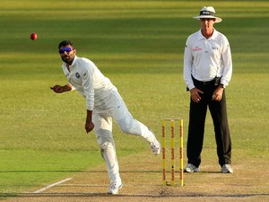 India's Ravindra Jadeja bowls during Day 2 of the second Sunfoil Series Cricket Test match between India and South Africa at the SAHARA Stadium Kingsmead in Durban on December 27, 2013