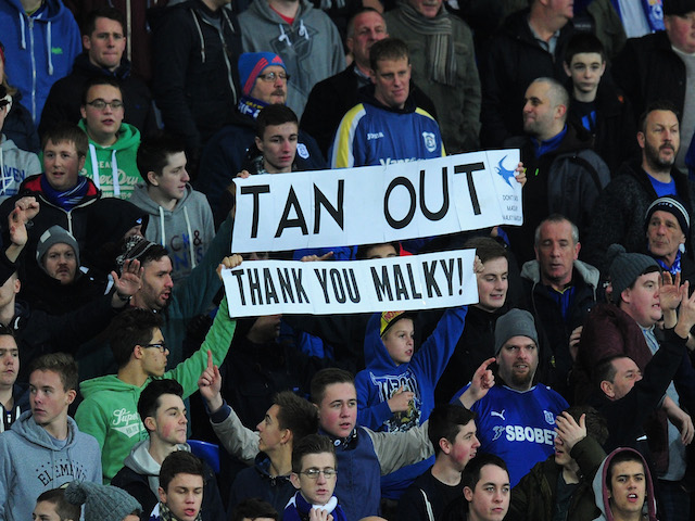 Cardiff fans show their support for former manager Malky MacKay during the Barclays Premier League match between Cardiff City and Sunderland on December 28, 2013