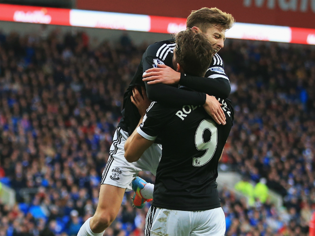 Jay Rodriguez of Southampton is congratulated by Adam Lallana after his opening goal during the Barclays Premier League match between Cardiff City and Southampton at Cardiff City Stadium on December 26, 2013
