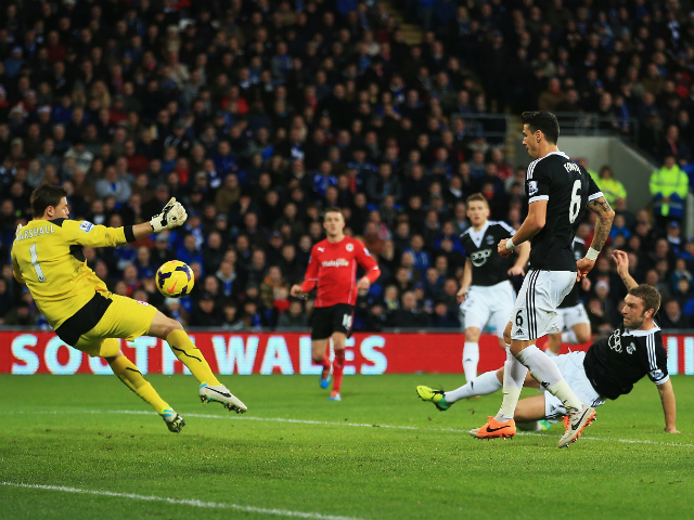 Rickie Lambert of Southampton scores his teams third goal during the Barclays Premier League match between Cardiff City and Southampton at Cardiff City Stadium on December 26, 2013