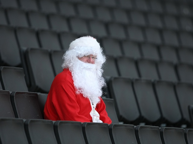 A lonely football fan sits in his Santa Claus costume at Stadium MK on October 15, 2011