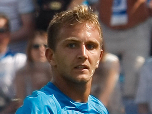 Domenico Criscito of FC Zenit St. Petersburg scores as Anton Shunin of FC Dynamo Moscow defends during the Russian Football League Championship match on July 22, 2013