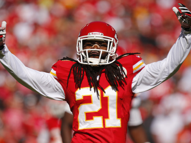 Dunta Robinson of the Kansas City Chiefs signals to the fans to get louder before a third down play against the Oakland Raiders in the third quarter October 13, 2013