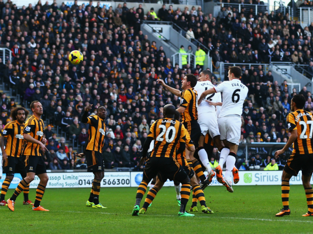 Chris Smalling of Manchester United scores his sides opening goal with a header during the Barclays Premier League match between Hull City and Manchester United at KC Stadium on December 26, 2013