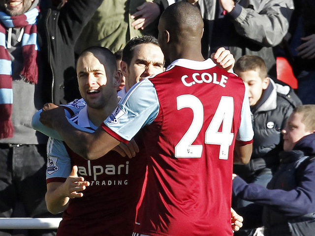 West Ham United's Joe Cole celebrates scoring the opening goal with Carlton Cole during the game with West Brom on December 28, 2013