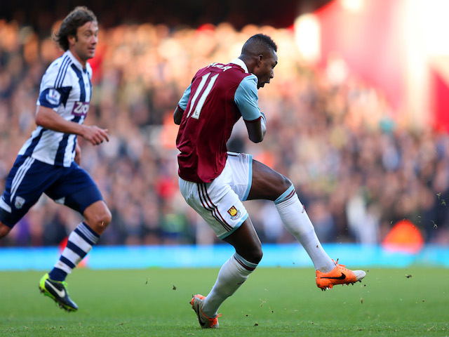 Modibo Maiga of West Ham scores their second goal during the Barclays Premier League match between West Ham United and West Bromwich Albion at Boleyn Ground on December 28, 2013