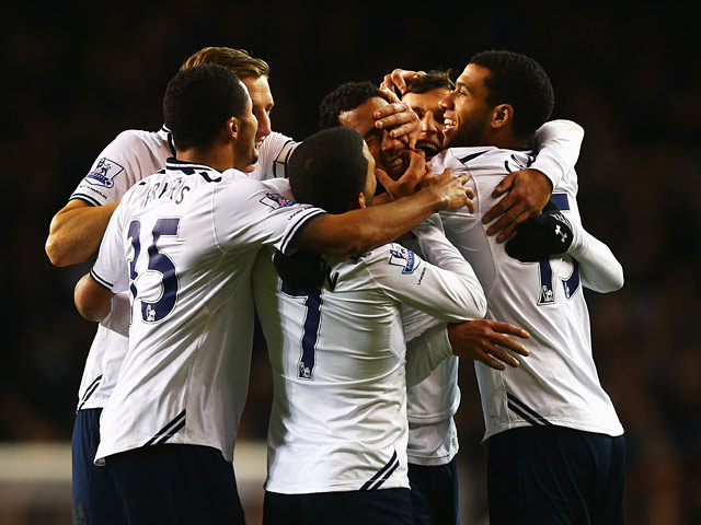 Tottenham's Mousa Dembele is mobbed by teammates after scoring the second goal against Stoke during their Premier League match on December 29, 2013
