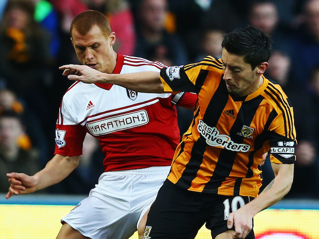 Robert Koren of Hull City holds off the challenge of Steve Sidwell of Fulham during the Barclays Premier League match on December 28, 2013