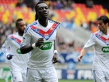 Lyon's French forward Bafetimbi Gomis (C) celebrates with teammates after scoring a goalduring a French Cup football match between La Suze-sur-Sarthe and Olympique Lyonnais on January 5, 2014