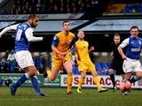 Ipswich's David McGoldrick scores the opening goal against Preston during their FA Cup third round match on January 4, 2013