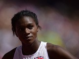 Great Britain's Dina Asher-Smith reacts after competing in a women's 200 M heat during the European Athletics Championships at the Letzigrund stadium in Zurich on August 14, 2014
