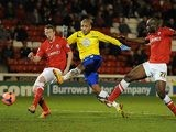 Coventry's Leon Clarke scores his team's second goal against Barnsley during their FA Cup third round match on January 4, 2013