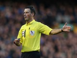 Referee Mark Clattenburg looks on during the Barclays Premier League match between Everton and Southampton at Goodison Park on December 29, 2013