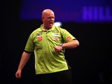 Michael van Gerwen of Holland celebrates winning a leg during his third round match against Terry Jenkins of England during the William Hill PDC World Darts Championships on Day Nine at Alexandra Palace on December 29, 2014