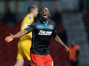 Stevenage's Francois Zoko celebrates after scoring the opening goal against Doncaster during their FA Cup third round match on January 4, 2013