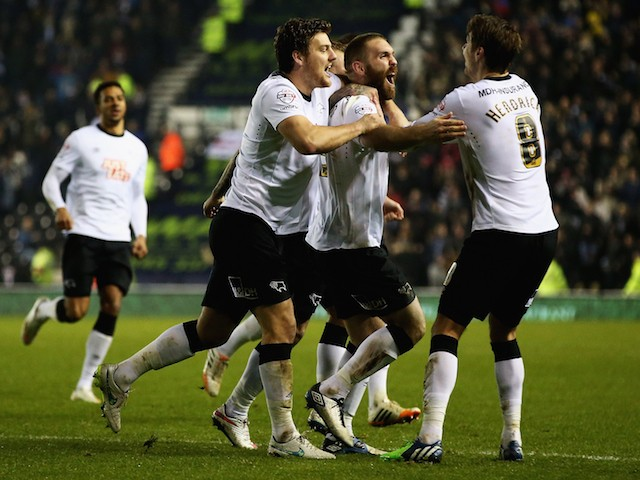 Jake Buxton of Derby County is congratulated on his goal during the Sky Bet Championship match against Leeds United on December 30, 2014