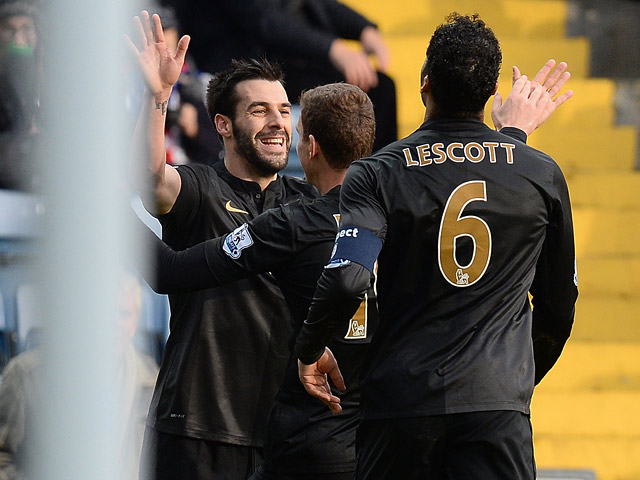 Man City's Alvaro Negredo is congratulated by teammates after scoring the opening goal against Blackburn during their FA Cup third round match on January 4, 2013