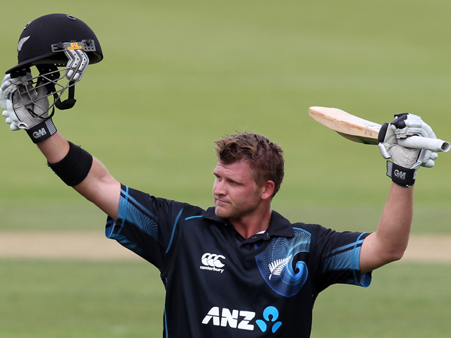 Corey Anderson of New Zealand celebrates scoring the fastest 100 runs in history during game three of the One Day International Series between New Zealand and the West Indies at Queenstown Events Centre on January 1, 2014