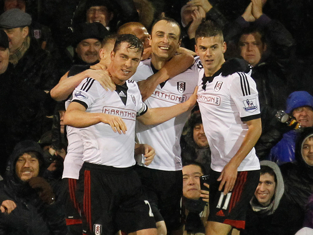 Fulham's Bulgarian striker Dimitar Berbatov celebrates scoring their second goal during the English Premier League football match between Fulham and West Ham United at Craven Cottage in London on January 1, 2014
