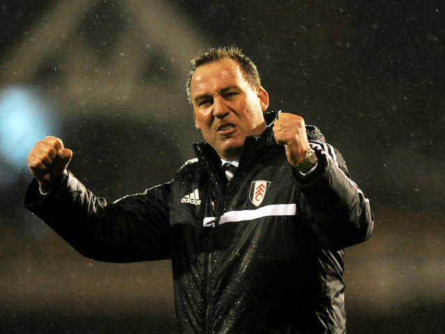 Rene Meulensteen the Fulham manager celebrates following his team's 2-1 victory during the Barclays Premier League match between Fulham and West Ham United at Craven Cottage on January 1, 2014
