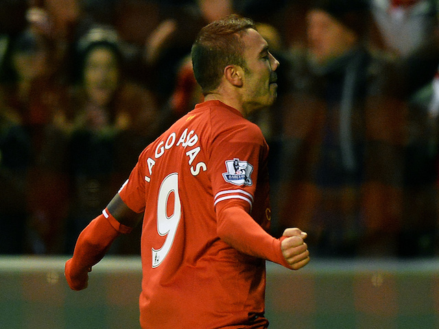 Liverpool's Spanish striker Lago Aspas (R) celebrates scoring a goal during the English FA Cup third round football match between Liverpool and Oldham Athletic at Anfield on January 5, 2014