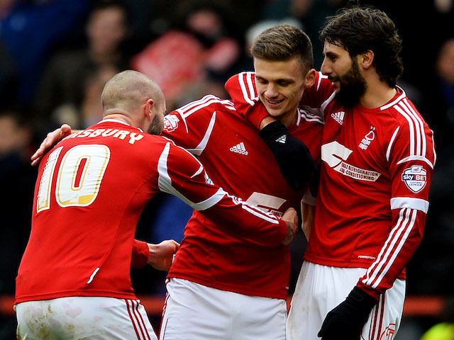 Jamie Paterson of Nottingham Forest (C) celebrates with Djamel Abdoun (R) and Henri Lansbury as he scores their second goal during the FA Cup game on January 5, 2014