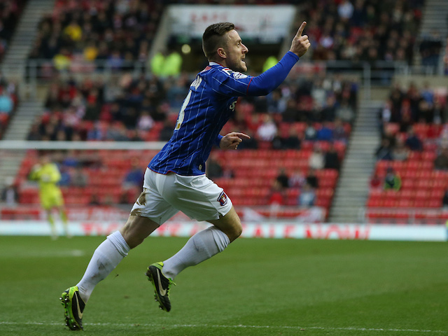 Carlisle United's English midfielder Matty Robson celebrates after scoring a goal during the English FA Cup third round football match against Sunderland on January 5, 2014